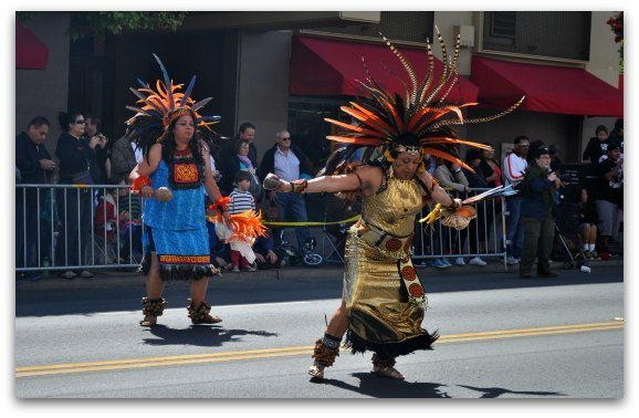 Aztec dancers in the Cesar Chavez holiday parade in San Francisco