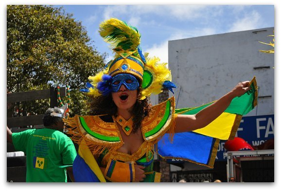 A colorful costume and dancer at the Carnaval Parade in SF in May.