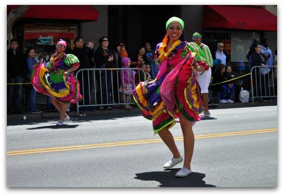 Colorful dancers in parade