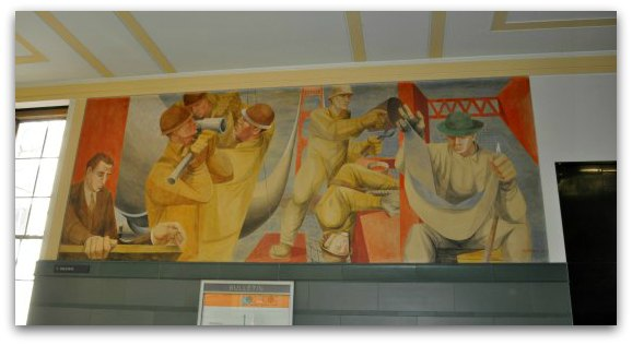 A mural showing the workers building the Golden Gate Bridge, in the Rincon Center in San Francisco.