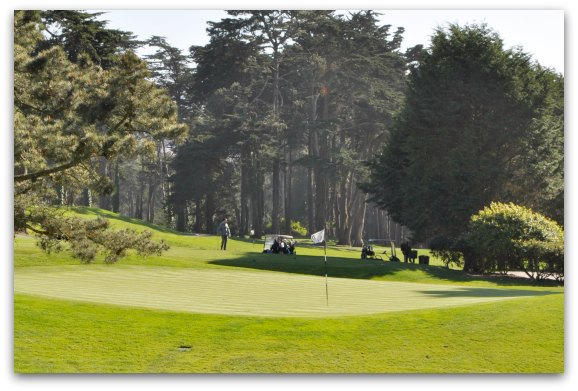 Golfers playing on the golf course in the Presidio.