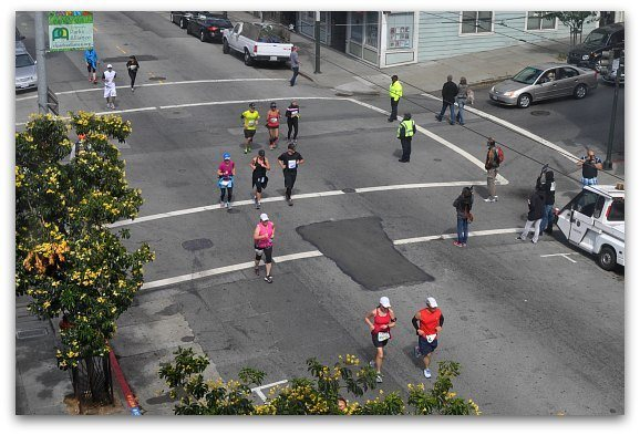 A group of people running in San Francisco.