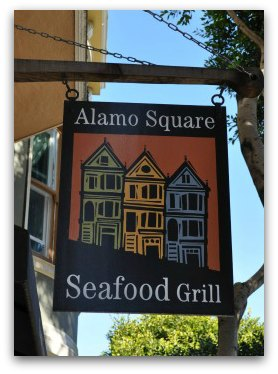 A sign for the Alamo Square Seafood Grill
