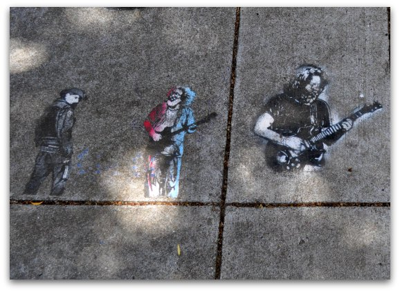 Emblems on the sidewalk in front of one of the Grateful dead houses in San Francisco.