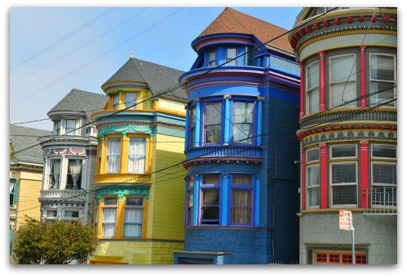 Colorful houses lining the street in the Haight Ashbury in SF