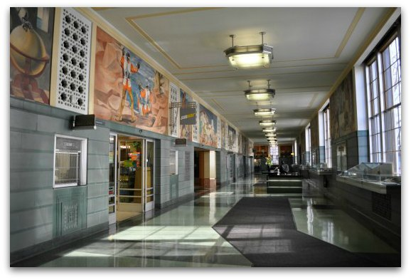 The main lobby of the Rincon Center showing its historic murals.