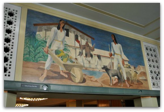 The Rincon Center mural showcasing the building of the Mission Dolores in San Francisco.